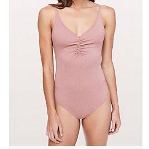 Lululemon Pretty Pursuit Bodysuit NWOT